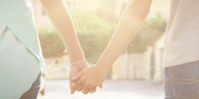 women_hold_hands